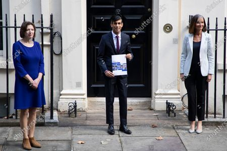 Chancellor Rishi Sunak (centre) holds a copy of his Winter Economy Plan as he stands outside 11 Downing Street with Director general of the CBI Dame Carolyn Julie Fairbairn(right) and General Secretary of The TUC Frances O'Grady (left) . Later today the Chancellor will present his Winter Economy Plan to Parliament.