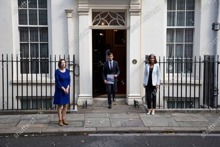 Stock Photo of Chancellor Rishi Sunak (centre) holds a copy of his Winter Economy Plan as he stands outside 11 Downing Street with Director general of the CBI Dame Carolyn Julie Fairbairn(right) and General Secretary of The TUC Frances O'Grady (left) . Later today the Chancellor will present his Winter Economy Plan to Parliament.