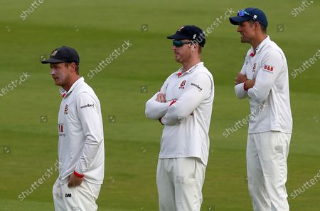 Tom Westley (l), Simon harmer (c) and Sir Alastair Cook keep their hands warm as they await the next ball during Somerset CCC vs Essex CCC, Bob Willis Trophy Final Cricket at Lord's Cricket Ground on 24th September 2020