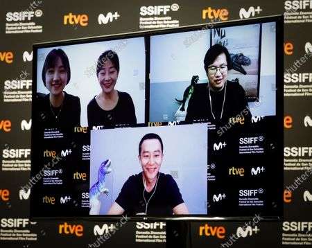 Stock Image of Chinese film director Ziang Zhou (R, up), actor Huang Xuan (down) and producers Luna Wang and Yini Qian (L, up) take part, via video-conference, in an online presentation of their movie 'Wuhai' at the 68th annual San Sebastian International Film Festival (SSIFF), in San Sebastian, Spain, 24 September 2020. The film festival runs from 18 to 26 September 2020 under safety measures like obligatory face mask use and red carpets without public due to the Covid-19 coronavirus pandemic. Organizers have also reduced the number of film screenings as well as the seating capacity in cinemas.