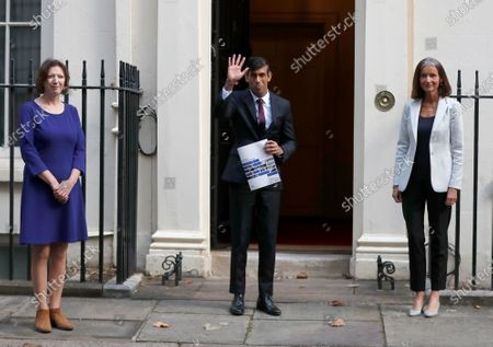 Britain's Chancellor of the Exchequer Rishi Sunak, centre, poses for photographers with Dame Carolyn Julie Fairbairn, right, Director General of the CBI, Confederation of British Industry, and Frances O'Grady, General Secretary of the TUC, Trades Union Congress, outside No 11 Downing Street, before heading for the House of Commons to give MPs details of his Winter Economy Plan, in London