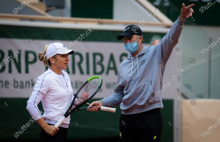 Stock Image of Simona Halep of Romania and coach Darren Cahill during practice before the start of the 2020 Roland Garros Grand Slam tennis tournament