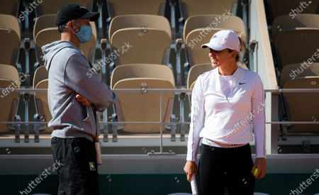 Stock Photo of Simona Halep of Romania and coach Darren Cahill during practice before the start of the 2020 Roland Garros Grand Slam tennis tournament