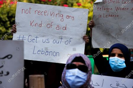 Syrian refugees protest outside the headquarters of the United Nations refugee agency, UNHCR, demanding to be moved out of Lebanon, which is undergoing its worse economic crisis in history with rising unemployment and poverty levels, in Beirut, Lebanon, . Lebanon, home to nearly 1 million Syrian refugees, has called for international help to secure their safe return, saying that they can no longer afford to host them