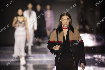 """Model Gigi Hadid wears a creation by designer Burberry at the Autumn/Winter 2020 fashion week runway show in London. Hadid and musician boyfriend Zayn Malik took to social media, Thursday, Sept. 24, to celebrate the arrival of an infant girl, with dad saying he's """"grateful"""" and """"thankful"""