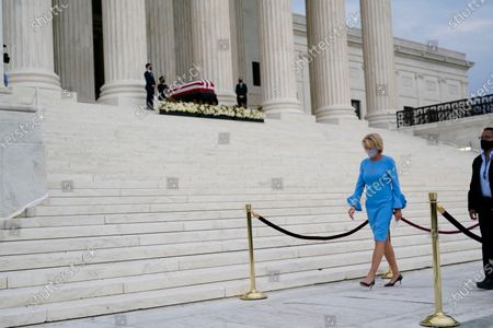 Education Secretary Betsy DeVos pays respects as Justice Ruth Bader Ginsburg lies in repose under the Portico at the top of the front steps of the U.S. Supreme Court building, in Washington. Ginsburg, 87, died of cancer on Sept. 18