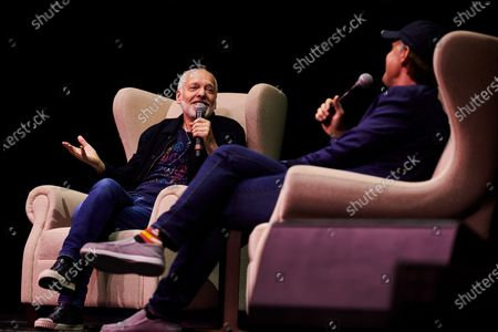 Stock Image of English rock musician Peter Frampton (L) and American blues guitarist Joe Bonamassa photographed at a Q&A session during the Keeping The Blues Alive At Sea event on board the Norwegian Pearl cruise ship in the Mediterranean