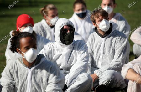 Climate activists, wearing white overalls and face masks, take part in an action training at a camp of the 'Ende Gelaende' protest initiative in the Rhenish coal mining area in Erkelenz, Germany, 24 September 2020. Several thousand demonstrators are expected to participate in the 'Ende Gelaende' movement's protest event aimed at RWE's Tagebau Garzweiler open-pit coal mine from 25 to 27 September 2020. Other environmental movements like 'Fridays for Future,' 'All villages stay!,' and the 'Anti-Coal Kids' support the protest.