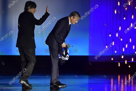 Actor and film director Viggo Mortensen, right, salutes after receiving the Donostia Award from Agustin Diaz Yanes for his contribution to the cinema during the 68th San Sebastian Film Festival, in San Sebastian, northern Spain