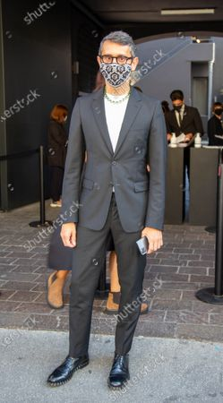 Simone Marchetti director of Vanity Fair is photographed before entering the number 21 fashion show during Milan Fashion Week.