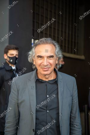 The president of the Chamber of Fashion Carlo Capasa is photographed before entering the number 21 fashion show during Milan Fashion Week.