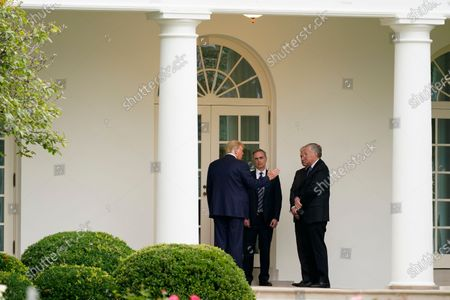 President Donald Trump, left, speaks with White House counsel Pat Cipollone, national security adviser Robert O'Brien and White House chief of staff Mark Meadows outside the Oval Office of the White House after visiting the Supreme Court to pay respects to Justice Ruth Bader Ginsburg, in Washington