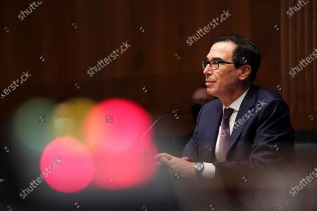 Treasury Secretary Steve Mnuchin testifies during the Senate's Committee on Banking, Housing, and Urban Affairs hearing examining the quarterly CARES Act report to Congress on Capitol Hill, in Washington