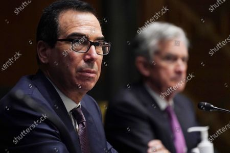 Federal Reserve Chair Jerome Powell, right, and Treasury Secretary Steve Mnuchin testify during the Senate's Committee on Banking, Housing, and Urban Affairs hearing examining the quarterly CARES Act report to Congress on Capitol Hill, in Washington