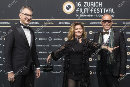 Shania Twain poses next to Christian Jungen, Artistic Director Zurich Film Festival, left, on the Green Carpet for the Opening Night of the 16th Zurich Film Festival (ZFF) in Zurich, Switzerland, 24 September 2020.