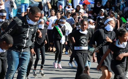 """People dance to Jerusalema in Cape Town, South Africa, . South Africans of all walks of life are dancing to """"Jerusalema,"""" a rousing anthem to lift their spirits amid the battle against COVID-19. In response to a call from President Cyril Ramaphosa to mark the country's Heritage Day holiday Thursday, people from townships to posh suburbs are doing line dances to the tune"""