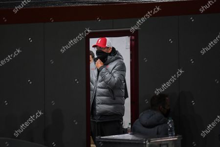Jurgen Klopp manager of Liverpool stands inside the temporary dressing room of the away team
