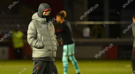 Liverpool Manager Jurgen Klopp watches the Lincoln Players warm up
