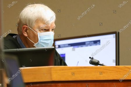 Stock Picture of Judge Robert Wilbrandt addresses the court prior to an arraignment for former Illinois Department of Children and Family Services employee Carlos Acosta at the McHenry County Courthouse,, in Woodstock. Acosta, who investigated allegations of abuse involving a 5-year-old boy whose beaten body later was found in a shallow grave, pleaded not guilty Thursday to child endangerment and reckless conduct charges