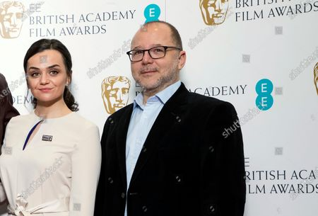 """Chair of the Film Committee Marc Samuelson poses for photographers next to actor Hayley Squires in London. The British Academy of Film and Television Arts promised to change after nominations for the 2020 awards were announced last January. No women were nominated as best director for the seventh year running, and all 20 nominees in the lead and supporting performer categories were white. """"We said on the day, 'We're going to review everything,'"""" BAFTA film committee chairman Marc Samuelson said Thursday, Sept. 24. 2020 as the academy announced a slate of changes"""
