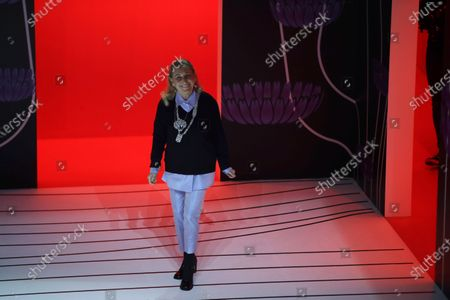 Miuccia Prada acknowledges the applauses at the end of her Prada women's Fall-Winter 2020-2021 fashion show, that was presented in Milan, Italy. Like other fashion designers participating in the Milan's fashion week Prada showed their collection on Thursday, Sept. 24, 2020, in a digital form. Prada said that she had always ''tried to ignore'' technology. But during Italy's strict lockdown, which shut down all nonessential industries, Prada said that she began to see technology as ''a kind of extension of ourselves