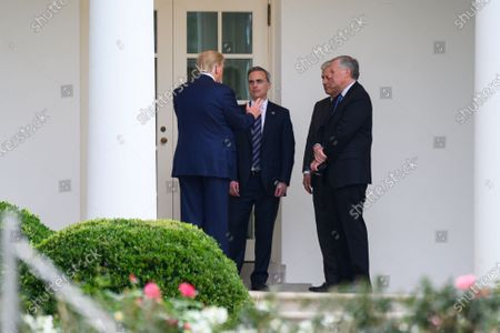 US President Donald Trump speaks with White House counsel Pat Cipollone, national security adviser Robert O'Brien and White House chief of staff Mark Meadows outside the Oval Office of the White House in Washington, DC, USA, 24 September 2020.
