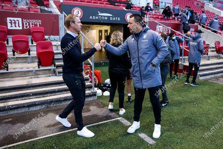 Bristol City head coach Dean Holden greets Aston Villa assistand manager John Terry