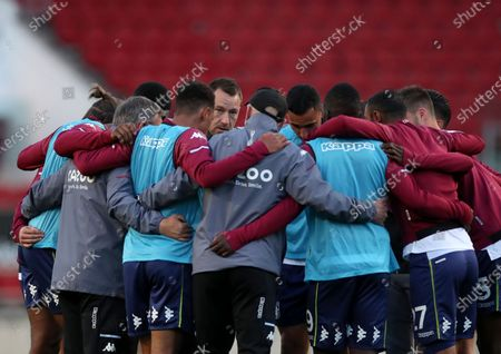 Aston Villa assistant head coach John Terry speaks with players during warmup before the English League Cup soccer match between Bristol City and Aston Villa at the Ashton Gate, in Bristol, England