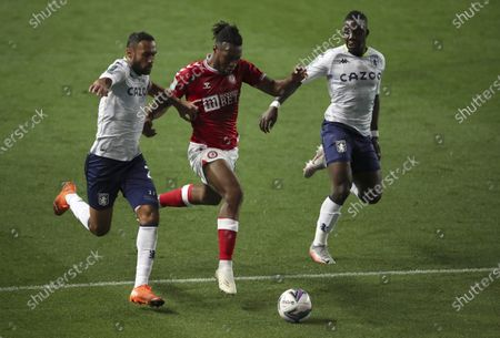 Bristol City's Antoine Semenyo, centre, duels for the ball with Aston Villa's Ahmed Elmohamady, left, and Aston Villa's Marvelous Nakamba during the English League Cup soccer match between Bristol City and Aston Villa at the Ashton Gate, in Bristol, England