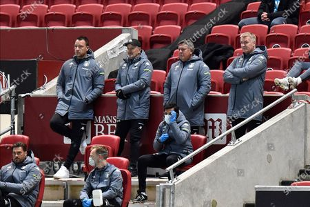 Aston Villa manager Dean Smith standing at the back of the dugout with his coaching staff which includes John Terry and Craig Shakespeare during the EFL Cup match between Bristol City and Aston Villa at Ashton Gate, Bristol