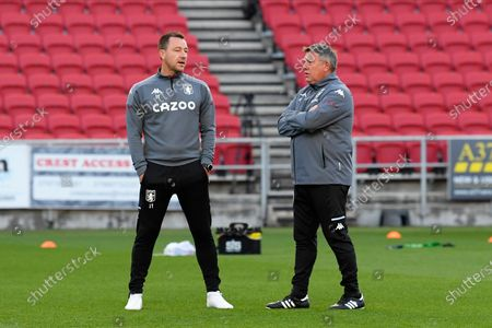 Stock Photo of Aston Villa assistant head coaches John Terry and Craig Shakespeare ahead of the EFL Cup match between Bristol City and Aston Villa at Ashton Gate, Bristol
