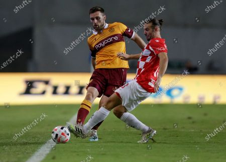 Stock Picture of Stephen O'Donnell of Motherwell, left, and Sean Goldberg of Hapoel Beersheba fight for the ball during Europa League qualifying round match in Beersheba