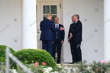 United States President Donald J. Trump speaks with White House counsel Pat Cipollone, national security adviser Robert O'Brien and White House chief of staff Mark Meadows outside the Oval Office of the White House after visiting the Supreme Court to pay respects to Justice Ruth Bader Ginsburg, in Washington, D.C., U.S., on Thursday, September 24, 2020.