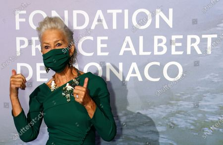 Actor Helen Mirren gestures as she poses on the red carpet ahead of the 2020 Monte-Carlo Gala for Planetary Health in Monaco, 24 September 2020.