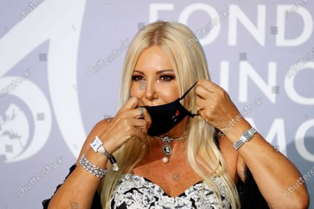 Monika Bacardi adjusts a face mask as she poses on the red carpet ahead of the 2020 Monte-Carlo Gala for Planetary Health in Monaco, 24 September 2020.