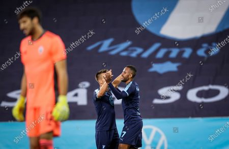 Malmo's Isaac Kiese Thelin (R) celebrates after scoring his second goal during the UEFA Europe League third qualifying round soccer match between Malmo FF and NK Lokomotiva Zagreb at Malmo New Stadium, in Malmo, Sweden, 24 September 2020.