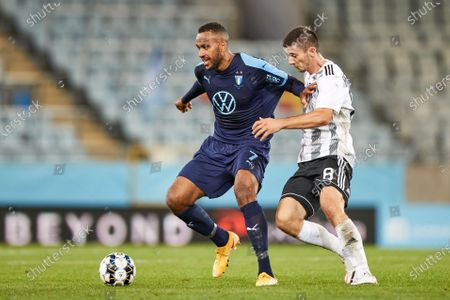 Malmo's Isaac Kiese Thelin (L) and Lokomotiva's Oliver Petrak (R) fight for the ball during the UEFA Europe League third qualifying round soccer match between Malmo FF and NK Lokomotiva Zagreb at Malmo New Stadium, in Malmo, Sweden, 24 September 2020.