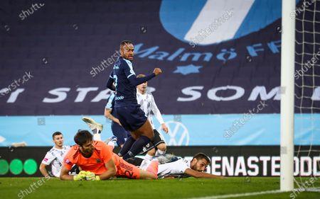 Stock Picture of Malmö's Isaac Kiese Thelin (#7) scores the opening goal at Lokomotiva's goalkeeper Krunoslav Hendija (bottom) during the UEFA Europe League third qualifying round match at Malmo New Stadium
