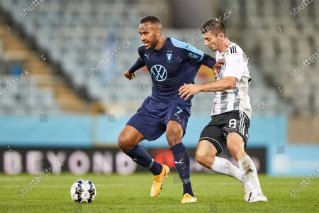 Stock Photo of Malmo's Isaac Kiese Thelin (L) and Lokomotiva's Oliver Petrak (R) fight for the ball during the UEFA Europe League third qualifying round match at Malmo New Stadium