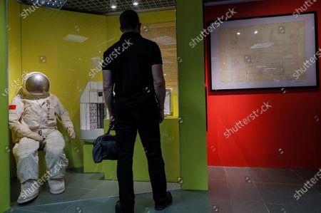 A visitor examines a model of a spacesuit for work in open space made by Saint Petersburg State Academy of Arts named after A.L. Stieglitz during opening exhibition ÕSpace designÕ in Space museum in Moscow, Russia, 24 September 2020. The exhibition presents works in the field of space design from the first space designer Konstantin Tsiolkovsky to projects of the future Russian Space programs developed by the Center for Prototyping of High Complexity Kinetics