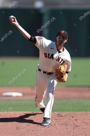 San Francisco Giants' Kevin Gausman throws against the Colorado Rockies during the second inning of a baseball game in San Francisco