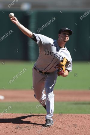 Colorado Rockies' Chi Chi González throws against the San Francisco Giants during the second inning of a baseball game in San Francisco
