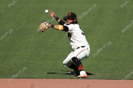 San Francisco Giants' Brandon Crawford attempts to field a single by Colorado Rockies' Kevin Pillar during the seventh inning of a baseball game in San Francisco