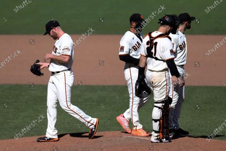 Stock Photo of San Francisco Giants Sam Coonrod, left, leaves the baseball game against the Colorado Rockies after allowing two runs during the seventh inning in San Francisco