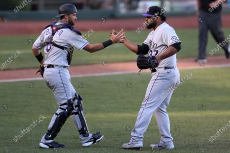 Stock Picture of Colorado Rockies' Drew Butera, left, celebrates with Jairo Díaz after the Rockies defeated the San Francisco Giants 5-4 in 11 innings in a baseball game in San Francisco