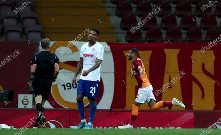 Stock Image of Galatasaray's Younes Belhanda (R) celebrates after scoring the 1-0 lead during the UEFA Europa League third qualifying round soccer match between Galatasaray and Hajduk Split in Istanbul, Turkey, 24 September 2020.