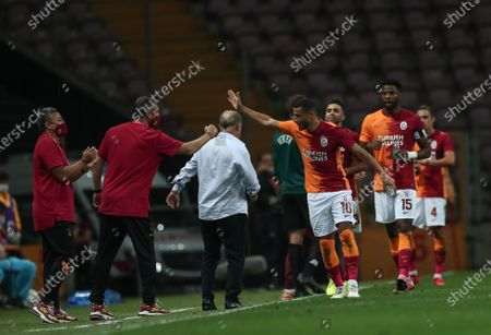 Galatasaray's Younes Belhanda (C-R) celebrates with teammates after scoring the 1-0 lead during the UEFA Europa League third qualifying round soccer match between Galatasaray and Hajduk Split in Istanbul, Turkey, 24 September 2020.