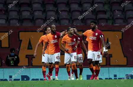 Stock Picture of Galatasaray's Younes Belhanda (C-R) celebrates with teammates after scoring the 1-0 lead during the UEFA Europa League third qualifying round soccer match between Galatasaray and Hajduk Split in Istanbul, Turkey, 24 September 2020.