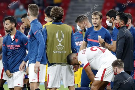 Stock Photo of Sevilla head coach Julen Lopetegui talks to players during the break before the game goes into extra time during the UEFA Super Cup final between Bayern Munich and Sevilla at the Puskas Arena in Budapest, Hungary, 24 September 2020.