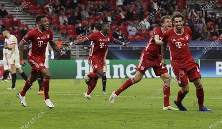 Javi Martinez (R) of Bayern Munich celebrates after scoring the second goal of his team during the UEFA Super Cup final between Bayern Munich and Sevilla at the Puskas Arena in Budapest, Hungary, 24 September 2020.